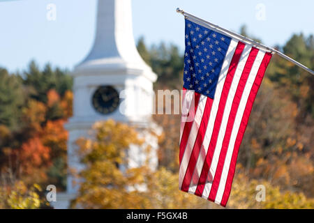 American flag flying in front of Stowe Community Church, in autumn, Stowe, Vermont USA - Stock Photo
