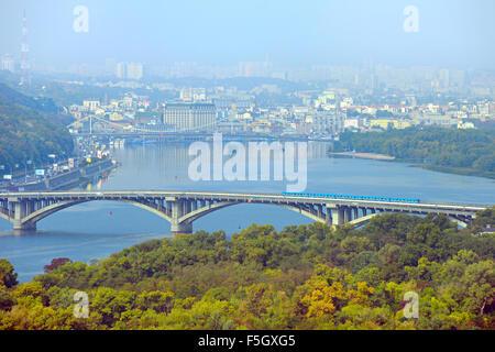 Aerial view of Metro bridge, Pedestrian bridge and Podil district on the background. Kiev, Ukraine - Stock Photo