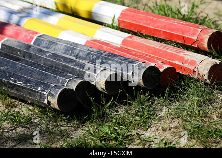 Barriers on the ground for jumping horses as a background - Stock Photo
