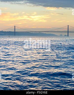 Lisbon bay with famous 25 April bridge. Portugal - Stock Photo