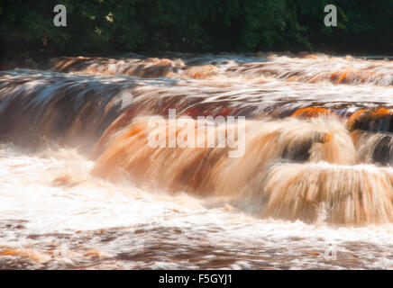 Water gushing over Richmond Falls, Richmond, Yorkshire - Stock Photo