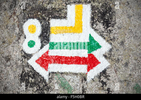 Hiking trails signs painted on rock. - Stock Photo