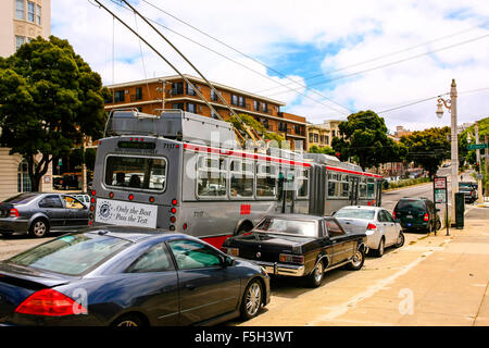 Traffic on Van Ness Ave in downtown San Francisco California - Stock Photo