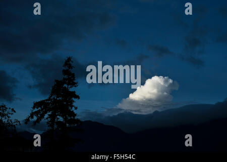 The morning sun lights up a cloud over the town of Sapa in Lao Cai Province, Vietnam - Stock Photo