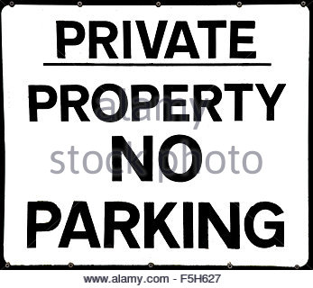 Black and white sign: PRIVATE PROPERTY NO PARKING - Stock Photo