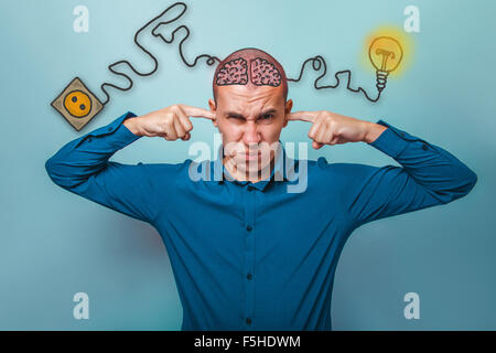 businessman man plugged his ears with your fingers does not want - Stock Photo