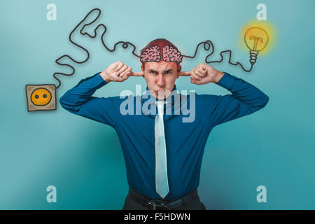 businessman man puffed out his cheeks and closed his hands over - Stock Photo