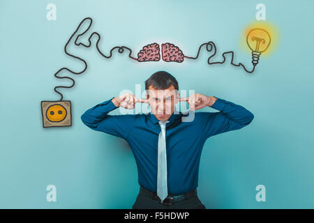 businessman man wrinkled fingers and ears plugged charging cord - Stock Photo
