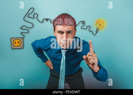 businessman raised his index finger up and frowned alert brain b - Stock Photo