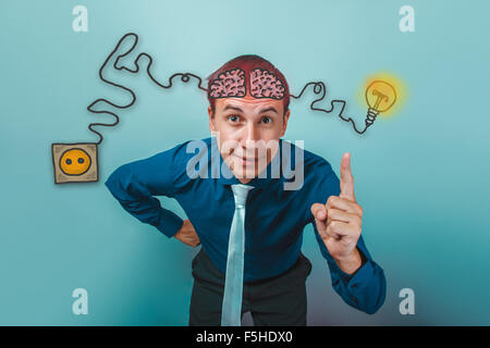 businessman smiling and raised his index finger up brain booster - Stock Photo