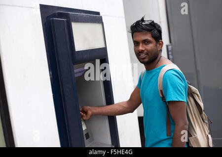 young man at the cash machine - Stock Photo