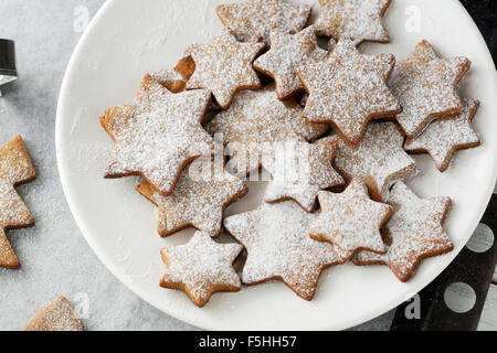 christmas star cookies on plate - Stock Photo