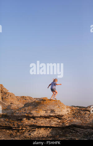 Sweden, Gotland, Faro, Gamle hamn, Side view of girl (10-11) hiking - Stock Photo