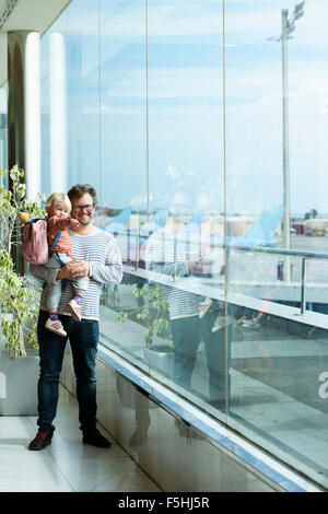 Spain, Tenerife, Tenerife South Airport, Father and daughter (2-3) at airport - Stock Photo