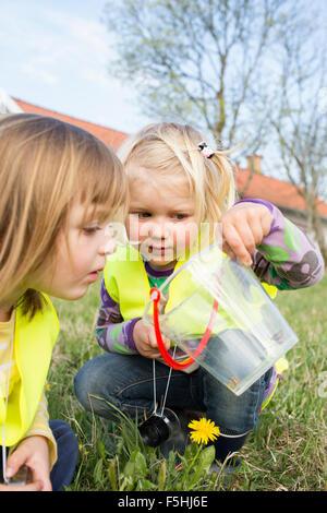 Sweden, Vastergotland, Olofstorp, Bergum, Kindergarten children (2-3, 4-5) playing outdoors - Stock Photo