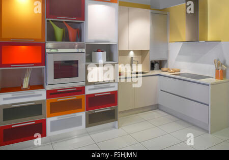 View of a domestic modern kitchen with cabinets, drawers, owen and ceramic cooking - Stock Photo