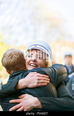 Sweden, Uppland, Stockholm, Young woman in traditional cap celebrating last day of high school - Stock Photo