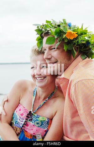 Sweden, Uppland, Roslagen, Couple embracing outdoors - Stock Photo