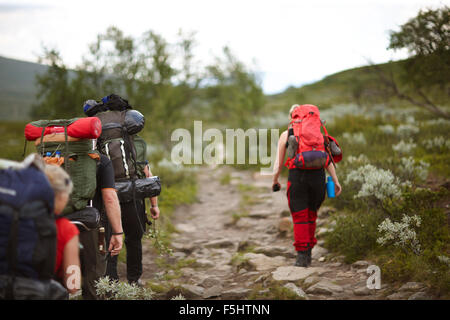 Sweden, Jamtland, People hiking with backpacks - Stock Photo