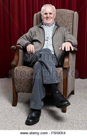 Man in armchair images galleries with for Sitting in armchair