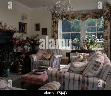 Striped armchair and sofa in nineties living room - Stock Photo