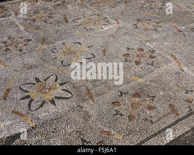 Well preserved Roman mosaic floor in the Ostia Antica excavation site near Rome, Italy - Stock Photo