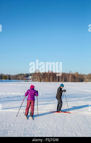 Female outdoor exercise in cold weather in winter - Stock Photo
