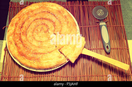greek chees pie on brown canvas - Stock Photo