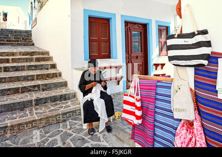 An old woman knit traditional handcrafts at the village Olympos in Karpathos, Greece - Stock Photo