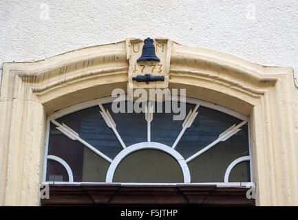 Sign of a bell and cannon above the door of the Mabilon bell foundry, 1773, Saarburg, Rheinland-Pfalz, Germany - Stock Photo