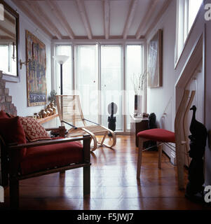 ... Polished Wooden Floor In A White Townhouse Living Room With Pale Wood  Furniture And Floor To