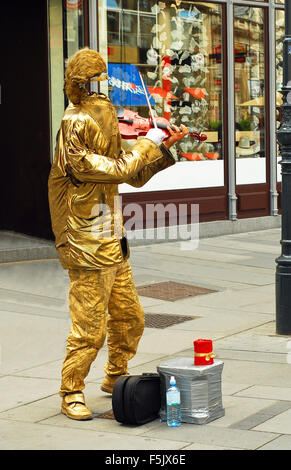 VIENNA, AUSTRIA - JUNE 20, 2011: Street performer playing violin in center of the austrian capital on July 20, 2011 - Stock Photo