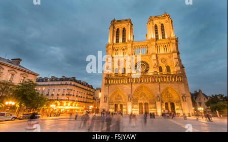 Notre Dame Cathedral at dusk, interior, western facade, Ile de la Cite, Paris, Region Ile-de-France, France Stock Photo