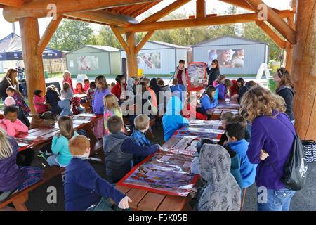 School children, 4th grade with teachers attending  demonstration. Life cycle the Coho & Chinook Salmon, Alaska - Stock Photo