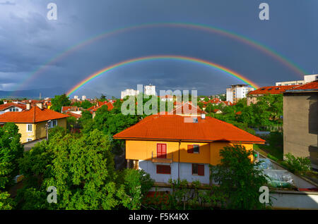 Double rainbow over the city - Stock Photo