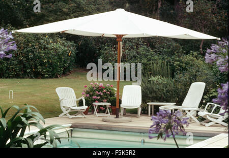 Large White Umbrella Above White Chairs And Table On White Tiled Stock Photo Royalty Free Image