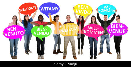 Refugees welcome in different languages group of young multi ethnic people isolated - Stock Photo