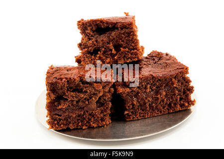 Brownies with plum jam isolated on white. - Stock Photo
