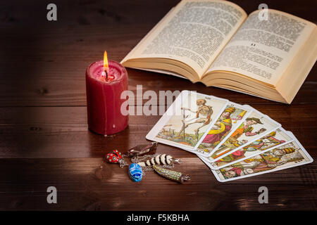 Composition of esoteric objects,candle,Tarots and book used for healing and fortune-telling. - Stock Photo