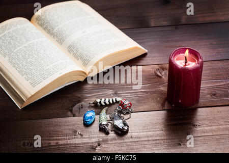 Composition of esoteric objects,candle and book used for healing and fortune-telling. - Stock Photo