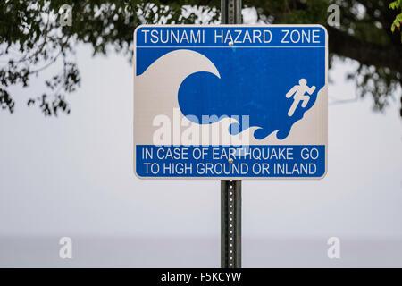 A Tsunami Hazard Zone sign in the Verne I. Richards park of Frederiksted, St. Croix, U.S, Virgin Islands. USVI, - Stock Photo