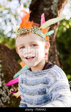 Sweden, Sodermanland, Strangnas, Portrait of smiling boy (4-5) wearing plume - Stock Photo