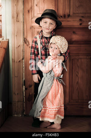 Sweden, Sodermanland, Strangnas, Boy (4-5) and girl (2-3) at home in costumes - Stock Photo