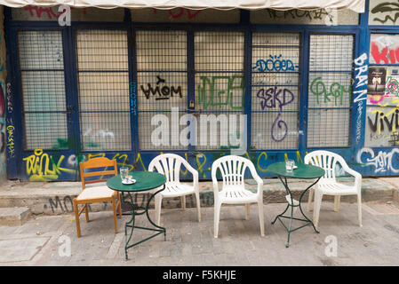 ATHENS, GREECE - OCTOBER 31, 2015: A simple and humble street cafe in Plaka - Stock Photo