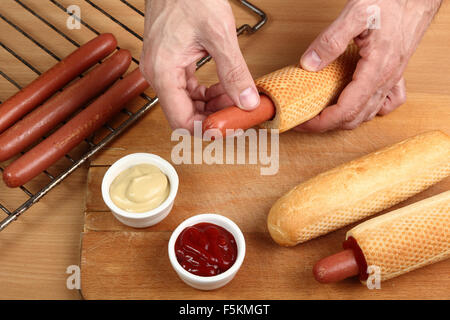 Making French Hot Dog - Stock Photo