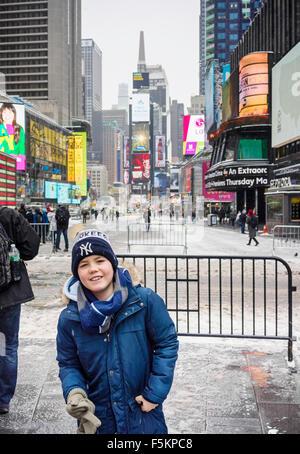 USA, New York, Manhattan, Times Square, Boy (12-13) on town square - Stock Photo
