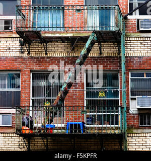 USA, New York State, New York City, Manhattan, View of fire escape staircase - Stock Photo