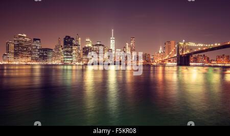 Vintage toned Manhattan waterfront at night, New York City, USA. - Stock Photo