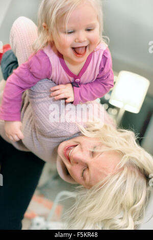 Sweden, Vastra Gotaland, Gothenburg, Mother playing with daughter (18-23 months) - Stock Photo