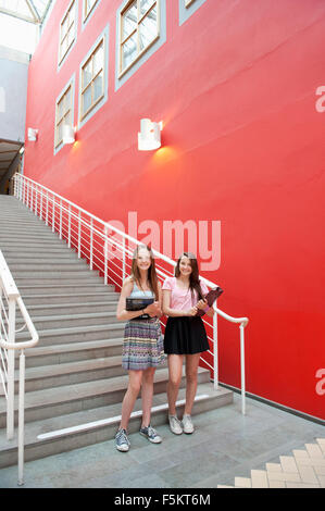 Sweden, Vastra Gotaland, Goteborg, Portrait of teenage girls (14-15) outside school - Stock Photo